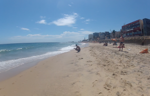 Farol da Barra beach - Tiny waves, awesome people, beautiful lighthouse at the very end.