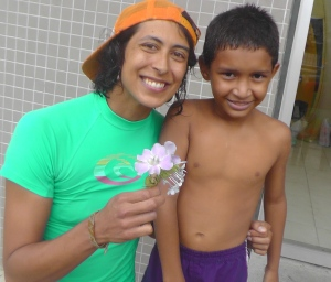With Danielo, a very special little friend who gave me these flowers while we were walking back from the beach